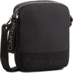Saszetka CALVIN KLEIN - Shadow Mini Reporter K50K503904 001. Czarne saszetki męskie Calvin Klein, z materiału, młodzieżowe. Za 279.00 zł.