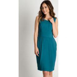 Sukienka bez rękawów w kolorze morskim BIALCON. Zielone sukienki damskie BIALCON, wizytowe, bez rękawów. W wyprzedaży za 145.00 zł.