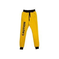 CAUTION PANTS. Żółte spodnie dresowe damskie Majors, z nadrukiem, z dresówki. Za 200.00 zł.