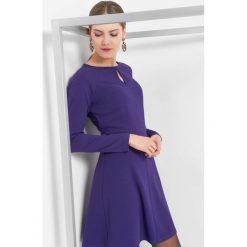 Sukienka z długim rękawem. Fioletowe sukienki damskie Orsay, z dzianiny, z długim rękawem. Za 79.99 zł.