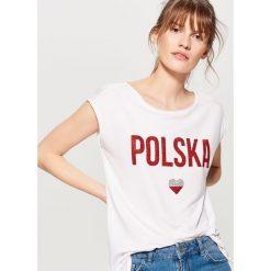 Koszulka mundialowa - Biały. T-shirty damskie marki DOMYOS. W wyprzedaży za 29.99 zł.