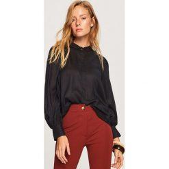 Koszula z bufiastymi rękawami - Czarny. Koszule damskie marki SOLOGNAC. W wyprzedaży za 59.99 zł.