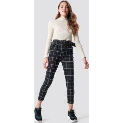 Trendyol Spodnie w kratkę - Black. Czarne spodnie materiałowe damskie Trendyol, w kratkę. Za 100.95 zł.