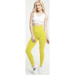 Gym Hero - Legginsy Yellow. Żółte legginsy sportowe damskie Gym Hero, z dzianiny. W wyprzedaży za 169.90 zł.