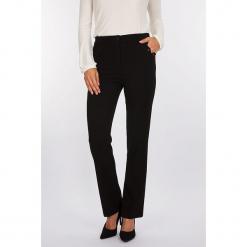 """Spodnie """"Castle"""" w kolorze czarnym. Czarne spodnie materiałowe damskie Scottage, z aplikacjami. W wyprzedaży za 90.95 zł."""