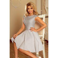 Sukienka rozkloszowana z koronką sf-157. Szare sukienki damskie SaF, w koronkowe wzory, z koronki, wizytowe. Za 189.00 zł.