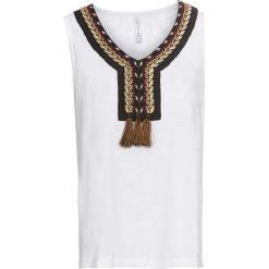 T-shirt z koronką i frędzlami bonprix biały. T-shirty damskie marki DOMYOS. Za 69.99 zł.