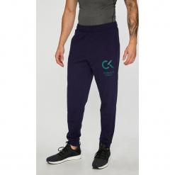 Calvin Klein Performance - Spodnie. Szare spodnie sportowe męskie Calvin Klein Performance, z bawełny. Za 269.90 zł.