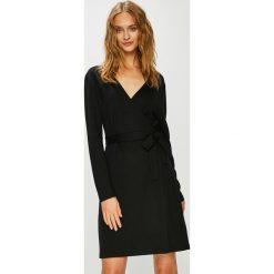 Calvin Klein - Sukienka. Brązowe sukienki damskie Calvin Klein, z dzianiny, casualowe, z długim rękawem. Za 699.90 zł.