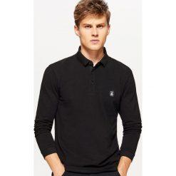 Koszulka polo z długimi rękawami - Czarny. Koszulki polo męskie marki INESIS. W wyprzedaży za 29.99 zł.