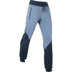 Spodnie sportowe, długie bonprix matowy niebieski - ciemnoniebieski melanż. Spodnie dresowe damskie marki WED'ZE. Za 74.99 zł.