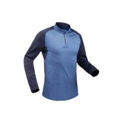 Koszulka turystyczna długi rękaw SH100 warm męska. Niebieskie bluzki z długim rękawem męskie QUECHUA, ze stójką. Za 39.99 zł.