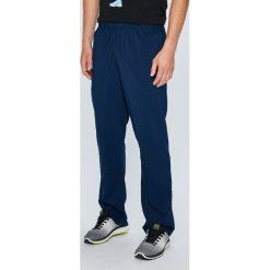 Reebok - Spodnie. Spodnie sportowe męskie marki bonprix. W wyprzedaży za 119.90 zł.