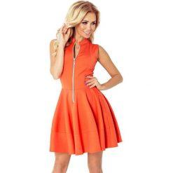 123-5 sukienka z ekspresem z przodu i kieszonkami - pomarańczowa - big. Brązowe sukienki damskie NUMOCO, z długim rękawem. Za 94.00 zł.