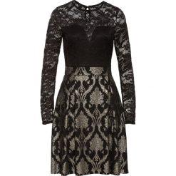 Sukienka z koronką bonprix czarny. Czarne sukienki damskie bonprix, w koronkowe wzory, z koronki. Za 124.99 zł.