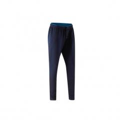 Spodnie treningowe do piłki nożnej TP500 damskie. Niebieskie spodnie sportowe damskie KIPSTA, z elastanu. Za 59.99 zł.
