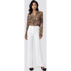 Trendyol Szerokie spodnie garniturowe - White. Białe spodnie materiałowe damskie Trendyol, z haftami. Za 100.95 zł.