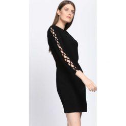 Czarna Sukienka Divergent. Czarne sukienki damskie Born2be, na jesień, z dzianiny. Za 59.99 zł.