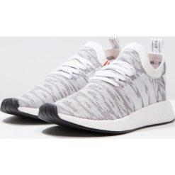 Adidas Originals NMD_R2 PK Tenisówki i Trampki white/core black. Trampki męskie adidas Originals, z materiału. W wyprzedaży za 629.10 zł.