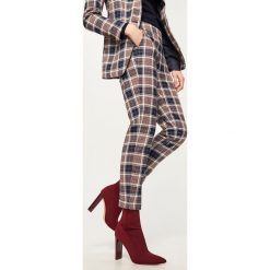 Spodnie w kratę - Wielobarwn. Spodnie materiałowe damskie marki DOMYOS. W wyprzedaży za 99.99 zł.