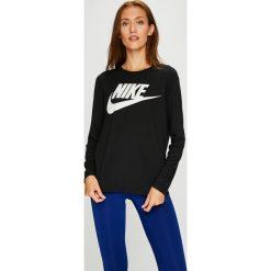 Nike Sportswear - Bluzka. Czarne bluzki damskie Nike Sportswear, z nadrukiem, z dzianiny, z okrągłym kołnierzem. W wyprzedaży za 139.90 zł.