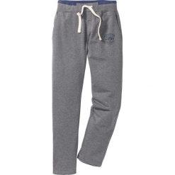 Spodnie sportowe z nadrukiem bonprix szary melanż. Spodnie sportowe męskie marki bonprix. Za 59.99 zł.