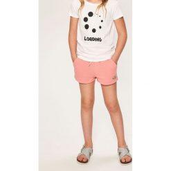 Krótkie spodenki dresowe - Pomarańczo. Spodenki dla dziewczynek Reserved, z dresówki. W wyprzedaży za 19.99 zł.