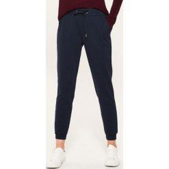 Dresowe joggery - Granatowy. Niebieskie spodnie dresowe damskie House, z dresówki. Za 59.99 zł.