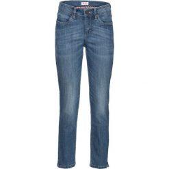Dżinsy ze stretchem i rozcięciami, dł. 7/8 bonprix niebieski. Jeansy damskie marki bonprix. Za 74.99 zł.