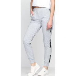 Szare Spodnie Dresowe Addiction. Szare spodnie dresowe damskie Born2be, z dresówki. Za 34.99 zł.