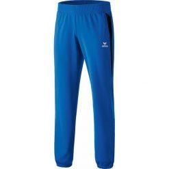 """Spodnie funkcyjne """"Premium One"""" w kolorze niebieskim. Spodnie sportowe dla chłopców marki 4f. W wyprzedaży za 65.95 zł."""