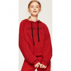 Bluza hoodie - Czerwony. Czerwone bluzy damskie Sinsay. Za 49.99 zł.