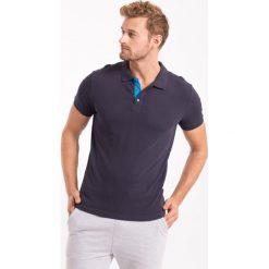 Koszulka polo męska TSM051AZ - GRANATOWY. Niebieskie koszulki polo męskie 4f, na jesień, z bawełny. Za 69.99 zł.