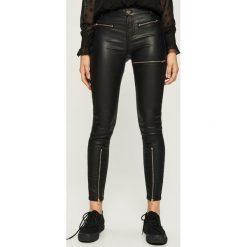 Spodnie skinny z zamkami - Czarny. Czarne spodnie materiałowe damskie Sinsay. Za 99.99 zł.