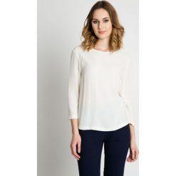 Oryginalna bluzka w kolorze ecru BIALCON. Czarne bluzki damskie BIALCON, z tkaniny, eleganckie, z klasycznym kołnierzykiem. W wyprzedaży za 130.00 zł.