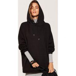 Bluza oversize - Czarny. Bluzy damskie marki KALENJI. W wyprzedaży za 49.99 zł.