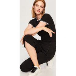 T-shirt z prążkowanej dzianiny - Czarny. T-shirty damskie marki DOMYOS. W wyprzedaży za 29.99 zł.