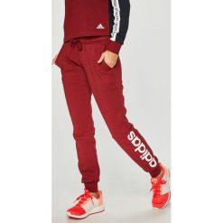 Adidas Performance - Spodnie. Szare spodnie sportowe damskie adidas Performance, z nadrukiem, z bawełny. W wyprzedaży za 139.90 zł.