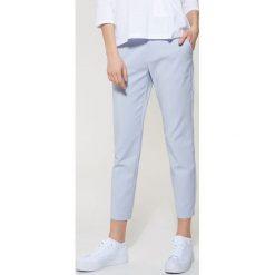 Spodnie typu chino - Niebieski. Spodnie materiałowe damskie marki DOMYOS. W wyprzedaży za 59.99 zł.