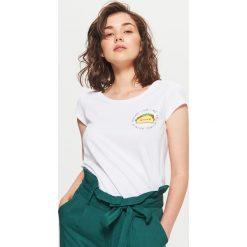 Koszulka z nadrukiem - Biały. T-shirty damskie marki DOMYOS. W wyprzedaży za 9.99 zł.