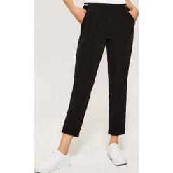 Spodnie chino - Czarny. Czarne spodnie materiałowe damskie House. Za 79.99 zł.
