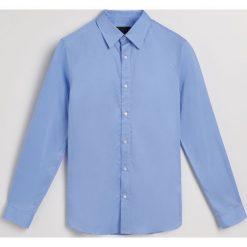 Koszula slim fit - Niebieski. Niebieskie koszule męskie Reserved. Za 139.99 zł.