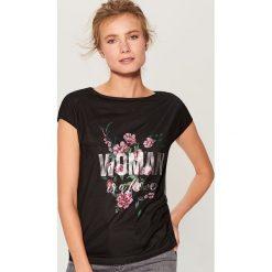 Koszulka z nadrukiem - Czarny. T-shirty damskie marki DOMYOS. W wyprzedaży za 29.99 zł.