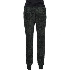 Spodnie drukowane bonprix czarny z nadrukiem. Spodnie materiałowe damskie marki DOMYOS. Za 79.99 zł.