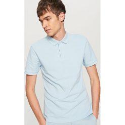 Klasyczna koszulka polo - Niebieski. Niebieskie koszulki polo męskie Reserved. Za 39.99 zł.