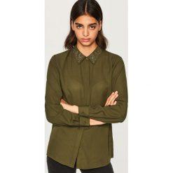 Koszula z ozdobnym kołnierzem - Khaki. Koszule damskie marki SOLOGNAC. W wyprzedaży za 39.99 zł.