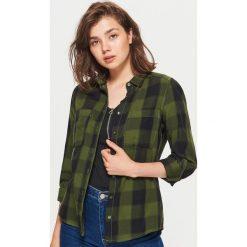 Koszula w kratę - Khaki. Koszule damskie marki SOLOGNAC. W wyprzedaży za 29.99 zł.