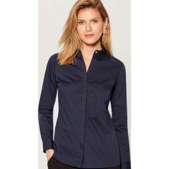 Klasyczna koszula z długimi rękawami - Niebieski. Koszule damskie marki SOLOGNAC. Za 79.99 zł.