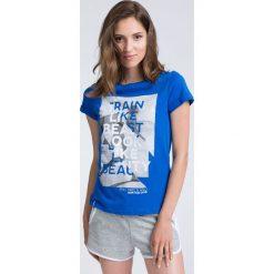 T-shirt damski TSD015 - granatowy. T-shirty damskie marki DOMYOS. W wyprzedaży za 49.99 zł.