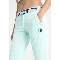 Fenty PUMA by Rihanna FITTED TRACK PANT Spodnie treningowe bay. Spodnie dresowe damskie Fenty PUMA by Rihanna, z bawełny. Za 719.00 zł.